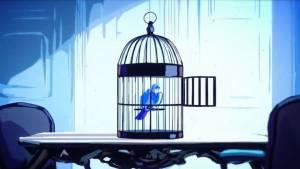 Oiseau dans une cage dont on a ouvert la porte